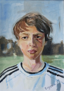 Grass Roots. Portrait of a young footballer