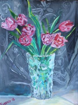 Tulips in crystal vase